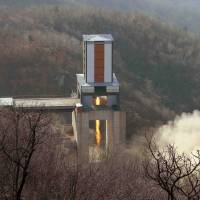 A new engine for a North Korean intercontinental ballistic missile (ICBM) is tested at the Sohae Space Center in Cholsan County, North Pyongan province in this undated photo released in April. | REUTERS