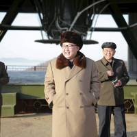 North Korea leader Kim Jong Un smiles as he visits Sohae Space Center in Cholsan County, North Pyongan province, for the testing of a new engine for an intercontinental ballistic missile (ICBM) in this undated photo released in April. | REUTERS