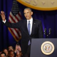 U.S. President Barack Obama waves before delivering his farewell address in Chicago on Tuesday. | AFP-JIJI