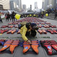 South Korea protestors demand president's removal, salvage of sunken ferry