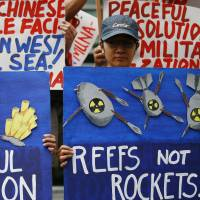 Filipinos want their rights asserted in disputed South China Sea, survey shows