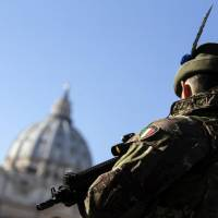 A soldier patrols St. Peter's square at the Vatican Sunday. | ANGELO CARCONI / ANSA VIA AP