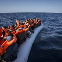 800 migrants rescued off six rubber boats as Libyan traffickers exploit weather window