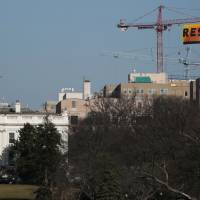 Greenpeace activists scale D.C. crane within sight of White House, hang huge 'RESIST' banner