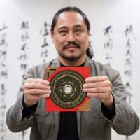 Feng shui master Alion Yeo poses during an interview in Hong Kong on Jan. 11.   AFP-JIJI