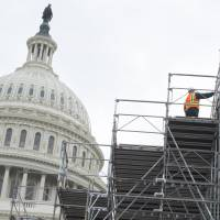 Workers build portions of the inaugural platform for the inauguration of President-elect Donald Trump at the U.S. Capitol in Washington, DC, Dec. 8. Trump ramped up preparations for his inauguration on Thursday, working with aides on an historic address that will be seen as a cornerstone of his administration. | AFP-JIJI