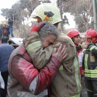 At least 30 firefighters among dead as historic Tehran high-rise crammed with unsafe shops collapses in flames