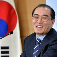 Thae Yong Ho laughs during a news conference at the Government Complex in Seoul on Dec. 27. | REUTERS