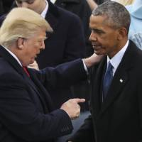 President Donald Trump points at Former President Barack Obama after his speech during the 58th Presidential Inauguration at the U.S. Capitol in Washington Friday. | AP