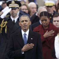 Former president Barack Obama and former first lady Michelle Obama listen as Jackie Evancho sings the U.S. National Anthem during the national anthem during inauguration ceremonies swearing in Donald Trump as the 45th president of the United States on the West front of the U.S. Capitol in Washington Friday. | REUTERS