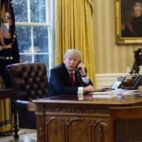 Trump kept sanctions out of Putin chat, tried to assure other leaders over NATO, immigrant ban