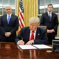 Trump signs executive order in first strike against 'Obamacare'