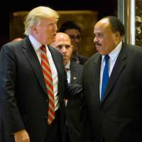 King Day puts spotlight on divisive transition from Obama to Trump