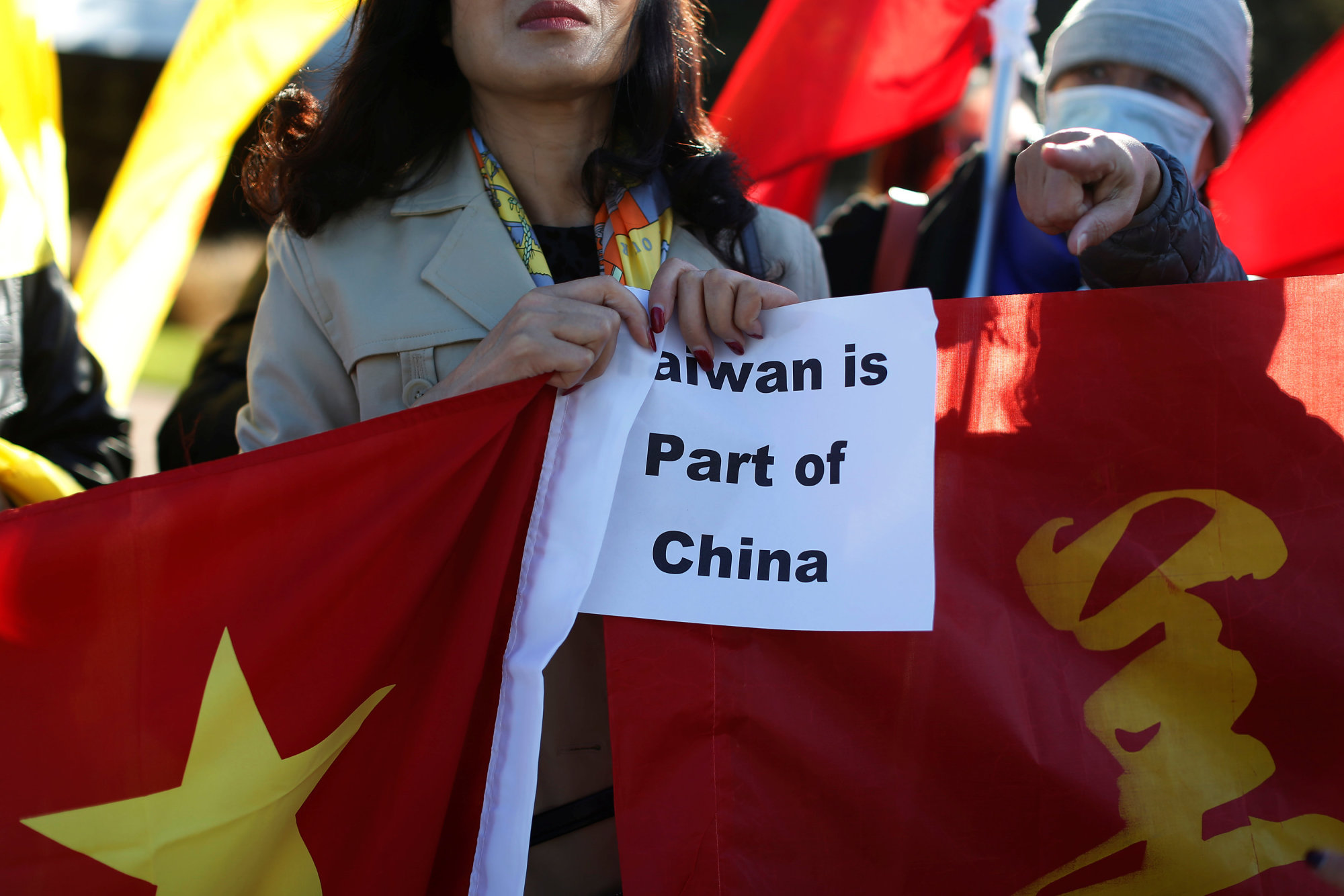 A demonstrator holds a sign in support of China during Taiwanese President Tsai Ing-wen's stopover after her visit to Latin America, in Burlingame, California, on Saturday.   REUTERS