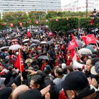 1,000 Tunisians march against return of jihadis; Libya suspect says journalist pair were executed