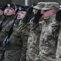 U.S. troops enter Poland in first deployment to Russia's doorstep