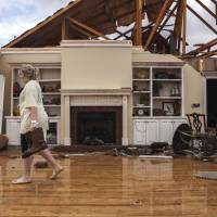 Southeast U.S. storm toll at 15, trailer park ravaged as more 'long track' twisters loom