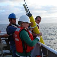 An Argo float, one of a global array of 3,800 free-drifting devices that capture data on ocean temperature, salinity and current velocities, is seen being deployed in this handout photo. | NATIONAL OCEANIC AND ATMOSPHERIC