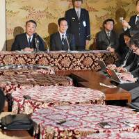 Upper House President Chuichi Date and Lower House Speaker Tadamori Oshima attend a news conference on Monday at the Diet. KYODO