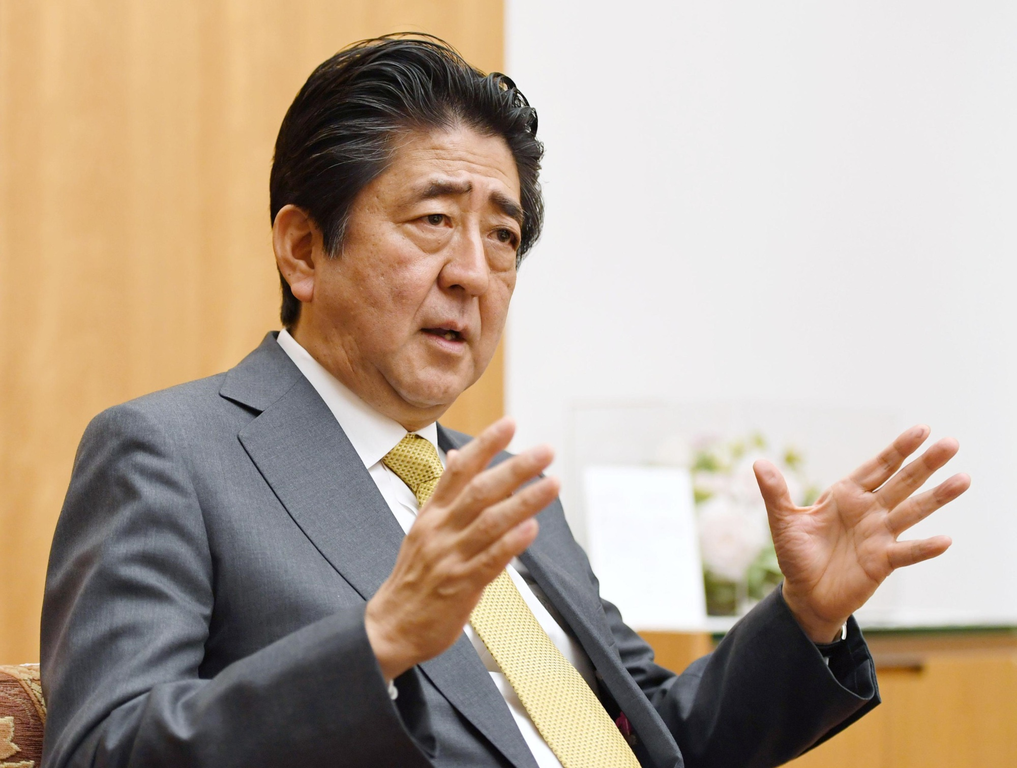 Shinzo Abe is interviewed in the Prime Minister's Office on Tuesday. | KYODO