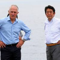 Abe, Turnbull sign pact boosting Japan-Australia defense ties