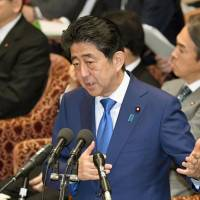 Abe warms to bilateral trade deal with U.S. but vows to still protect farmers