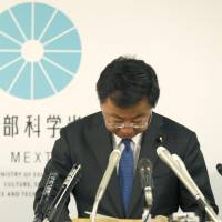 Education minister Hirokazu Matsuno bows in apology at a news conference Friday following the release of a government watchdog report on the ministry's illegal job-placement support for outgoing officials. | KYODO