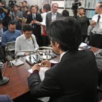 A father whose custody for his daughter was denied by the Tokyo High Court speaks at a news conference in Tokyo Thursday. | KYODO
