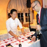 Global elites sample sushi, sake at Japan Night in Davos