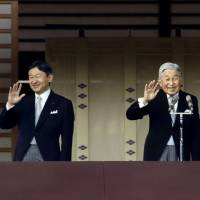 Crown Princess Masako, Crown Prince Naruhito, Emperor Akihito and Empress Michiko wave to well-wishers during the New Year's celebrations at the Imperial Palace on Monday. | KYODO