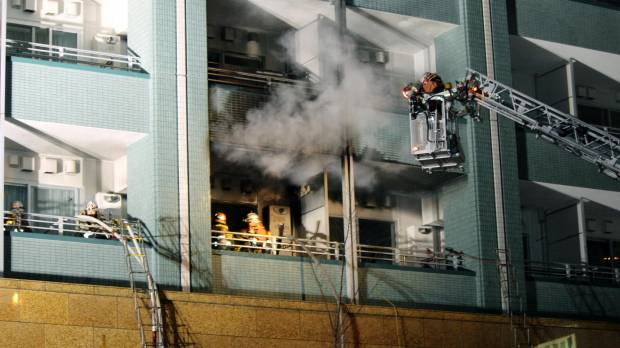 A blaze in Tokyo high-rise kills one, hospitalizes 10 others
