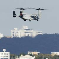An MV-22 Osprey flies over U.S. Marine Corps Air Station Futenma in Ginowan, Okinawa Prefecture, on Dec. 19 as the U.S. military resumed flights following a nonfatal accident off the coast a week earlier. | KYODO