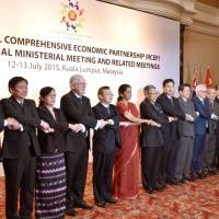 Trade ministers and officials from Asia-Pacific countries pose for photos in Kuala Lumpur on July 13, 2015, marking a fresh round of talks on a pending free trade scheme known as the Regional Comprehensive Economic Partnership. | KYODO