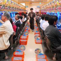 People play pachinko at a parlor in Tokyo. The government may submit a bill to address gambling addiction early this year. | BLOOMBERG