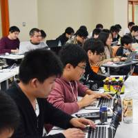 Participants answer computer security questions in Kanazawa, Ishikawa Prefecture, on Nov. 23 to prepare for Japan's annual 'white hat' Security Contest. | KYODO