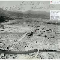 This aerial photo shows the A-bombed city of Hiroshima in January 1946. It carries signatures of three crew members of the Enola Gay. | HIROSHIMA PEACE MEMORIAL MUSEUM / VIA KYODO