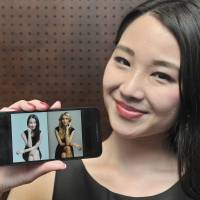 Miyu Toyonaga, sporting an Ivanka Trump-brand dress, shows a picture of herself posing like Ivanka, along with a photo of her lifestyle icon, during an interview in Tokyo last month.   YOSHIAKI MIURA