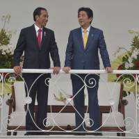 Indonesian President Joko 'Jokowi' Widodo and Prime Minister Shinzo Abe meet in the presidential palace in Bogor on Sunday. | AFP-JIJI