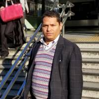 Bijay Gyawali, a 33-year-old clinical psychologist from Nepal, says the Japanese government brings in lots of workers on a student status (because) 'it needs a lot of workers.'  | TOMOHIRO OSAKI