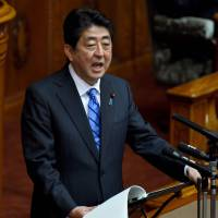 Prime Minister Shinzo Abe answers questions from the Upper House on Tuesday. The internet erupted after Abe misread the kanji 'unnun' as 'denden.' | AFP-JIJI