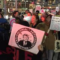 People join an Osaka rally to protest the new U.S. president Donald Trump ahead of the inauguration ceremony. | ERIC JOHNSTON