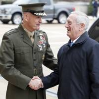 Joint Chiefs Chairman Gen. Joseph Dunford greets Defense Secretary James Mattis at the Pentagon on Saturday. | AP