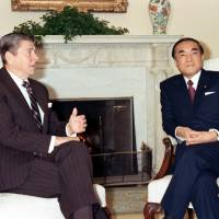 Prime Minister Yasuhiro Nakasone meets with U.S. President Ronald Reagan in January 1983 at the White House in Washington. | KYODO