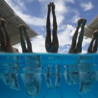 Members of France's synchronized swimming team dive into the pool during a training session at the Maria Lenk Aquatics Center in Rio de Janeiro, Brazil, last March. | AP