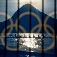 Rowers practice at the rowing venue in Lagoa at the 2016 Summer Olympics in Rio de Janeiro, Brazil, on Aug. 7. | AP