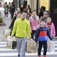 With consumer spending still weak, some economists argue the current expansion in the real estate market is being affected by speculative money from abroad. | KYODO