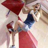 Miho Nonaka shows her sports climbing skills at a bouldering event in Tokyo in December. | KAZ NAGATSUKA