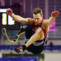 German long jumper Markus Rehm, seen at an indoor track and field event in Scotland in February 2016, had his bid to participate in the Rio Olympics rejected on the grounds that he could not prove his prosthetic leg did not give him an unfair advantage. | GETTY IMAGES / KYODO
