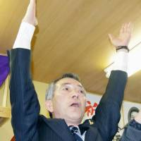 Mitsuharu Kanazawa celebrates his re-election as mayor of Oma, Aomori Prefecture, on Sunday. | KYODO