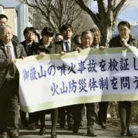 Relatives of volcanic eruption victims in Japan sue weather agency over alert